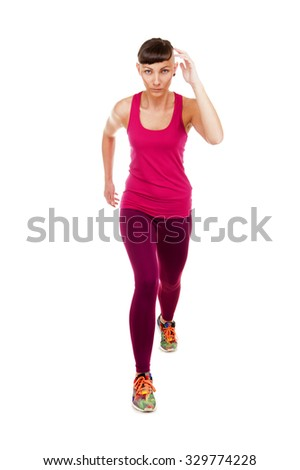Woman in fitness outfit running, isolated over white background.