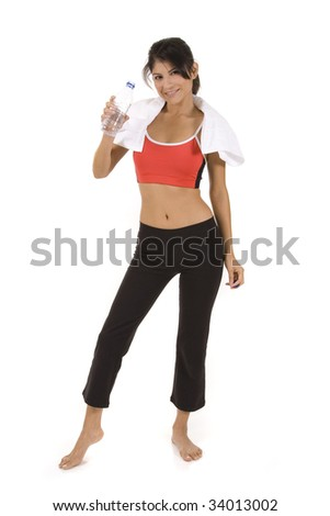 Woman in fitness pose holding water bottle.