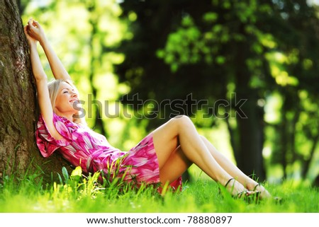 woman in forest on grass