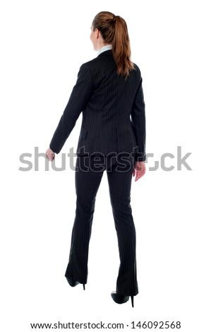 Woman in formals taking a walk