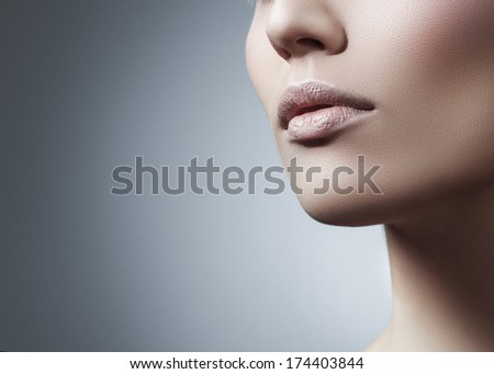 Woman in front of gray background - stock photo