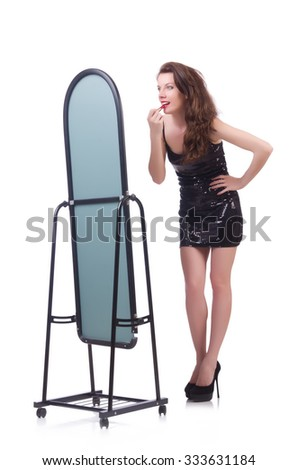 Woman in front of mirror - stock photo