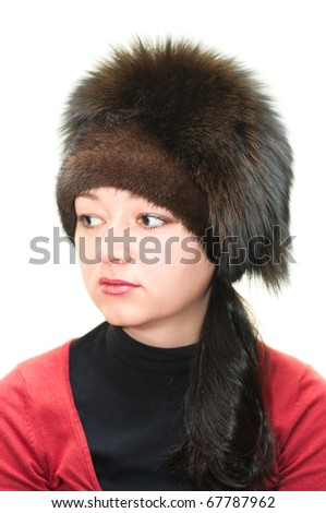 Woman in fur hat isolated on white background