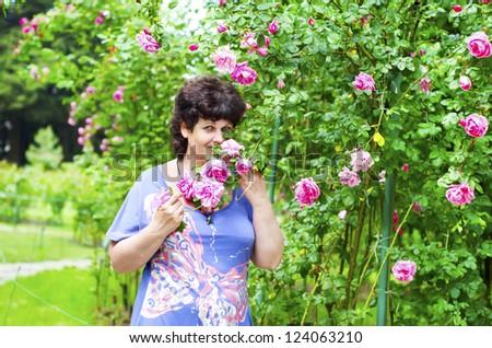 woman in garden - stock photo