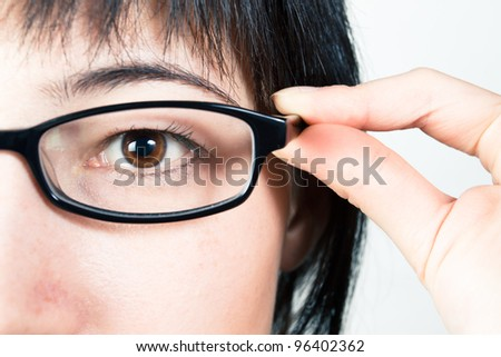 Woman in glasses. Close-up of eye. Ophthalmology concept