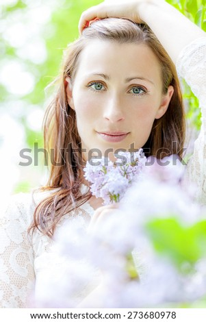 woman in green holding hair back - stock photo