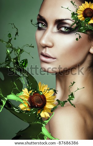 woman in green plant splash with sunflower