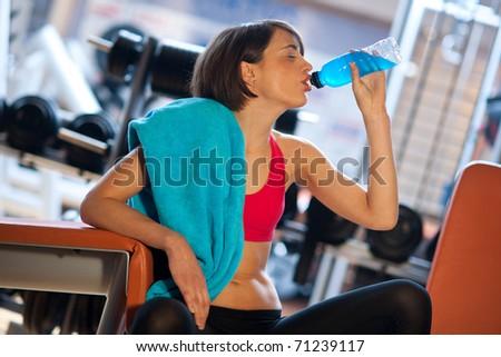 Woman gym drinks energy drink bottle stock photo 71239117 woman in gym drinks energy drink from bottle sciox Gallery