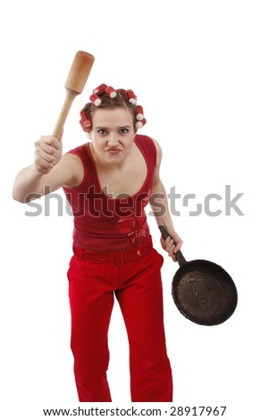 Woman in hair rollers. Housewife with curlers holding a frying pan.  ?oung girl with an angry expression. Very frustrated and angry mad woman. Angry look on face. Studio, white background. - stock photo