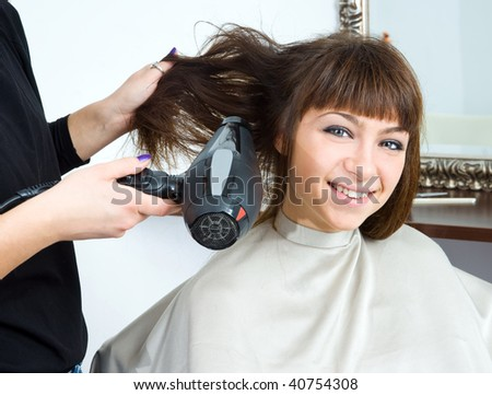woman in hair salon having treatment with hair blower - stock photo