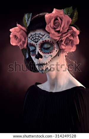 Woman in Halloween makeup - mexican Santa Muerte mask. - stock photo