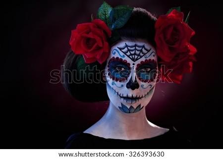 Woman in Halloween makeup - mexican Santa Muerte mask. - stock photo