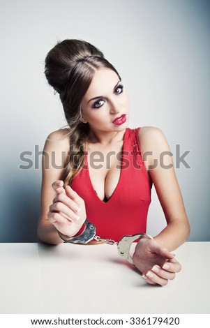 Woman in handcuffs - stock photo