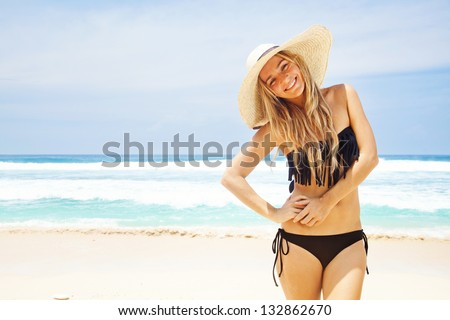 woman in hat on the beach