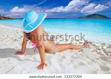Woman in hat relaxing on holiday at Andaman Sea, Thailand - stock photo