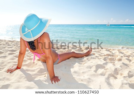 Woman in hat relaxing on holiday at Caribbean Sea - stock photo