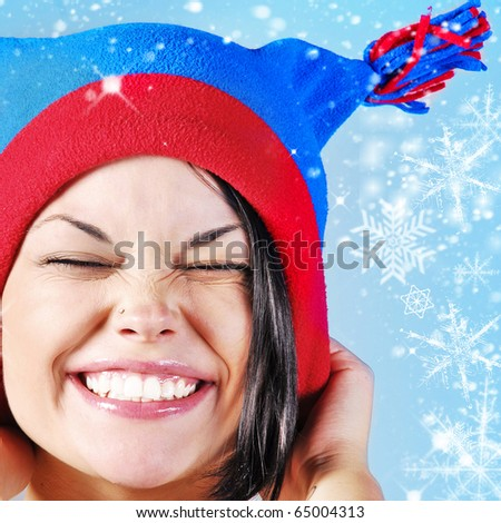 woman in hat with snowflake - stock photo