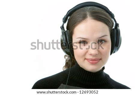 woman in head phones on white background