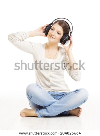 Woman in headphones listening to music. Woman portrait over white background  - stock photo