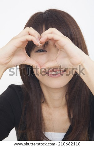 Woman In Heart-Shaped Hands