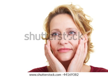 Woman in her 40s appyling lotion to her skin