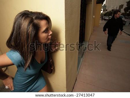 Woman in hiding - stock photo