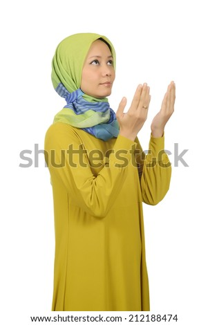 Woman in hijab praying isolated over white background - stock photo