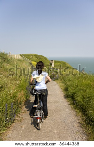 Woman in holidays cycling around Dover, UK