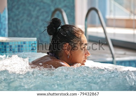 woman in jacuzzi - stock photo