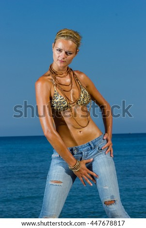 Woman in jeans at the beach in the summertime