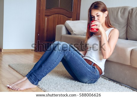 Woman Jeans Sitting On Carpet Near Stock Photo 588006626 ...