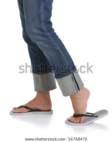 Woman in Jeans with Feet in Sandals - stock photo