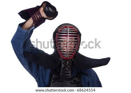 Woman in kendo uniform expressing victory. - stock photo