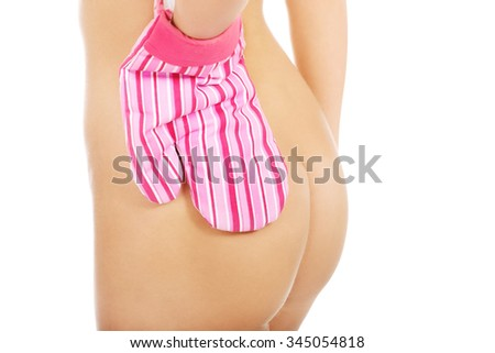 Woman in kitchen glove touching naked ass. - stock photo