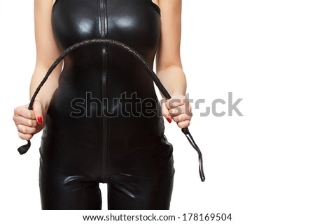 Woman in latex catsuit and whip, isolated on white background - stock photo