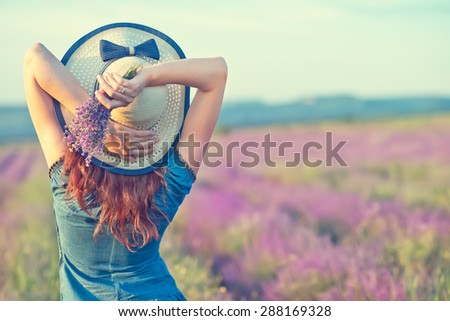 woman in lavender field - stock photo