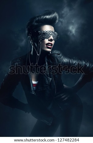 woman in leather jacket in the fog - stock photo