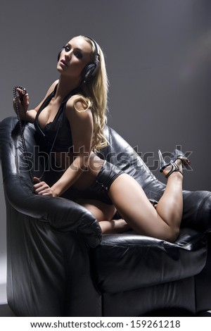 woman in lingerie with headphones  - stock photo