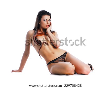 Woman in lingerie with snake - stock photo