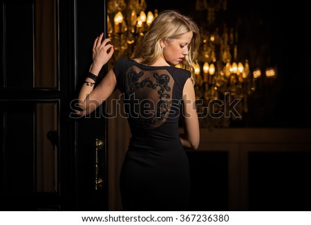 Woman in little black cocktail dress - stock photo