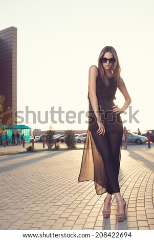 Woman in long black dress