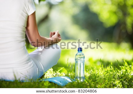 Woman in lotus position close-up - stock photo