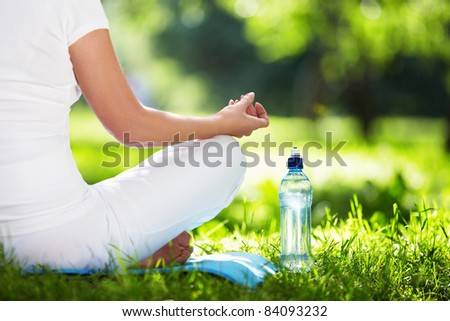 Woman in lotus position close-up