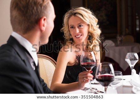 Woman in love looking at her date