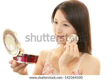 Woman in makeup - stock photo