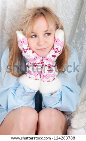 woman in man shirt with warm wool socks with hearts.