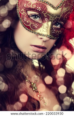 Woman in masquerade mask  - stock photo