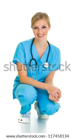 Woman in medical doctor suit isolated on white - stock photo
