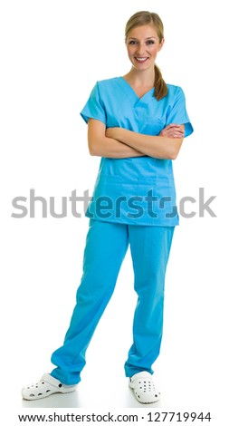 Woman in medical doctor suit isolated on white