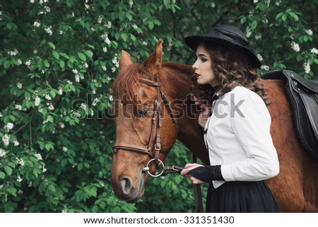 Woman in medieval dress walking with horse